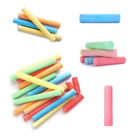 Set with colorful pieces of chalk on white background