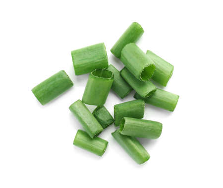 Cut green spring onion isolated on white, top view