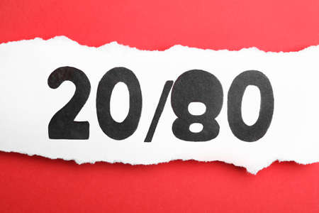 Sheet of paper with numbers 20 and 80 on red background, top view. Pareto principle concept