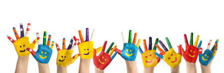 School holidays. Children with painted palms on white background, closeup