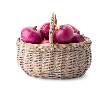 Basket full of onion bulbs isolated on white