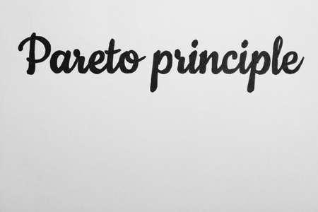 Words PARETO PRINCIPLE on white background, top view. Space for text Reklamní fotografie