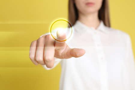 Woman pressing button on virtual screen, closeup