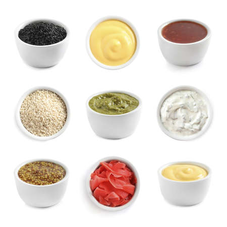 Set of different delicious sauces and condiments on white background