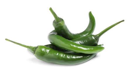 Green hot chili peppers on white background