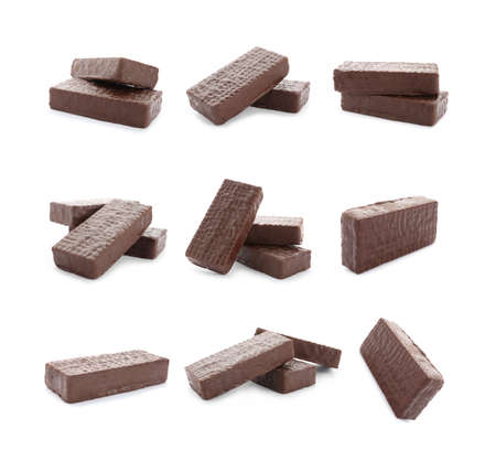 Set of delicious wafers with chocolate coating on white background. Sweet food Banque d'images