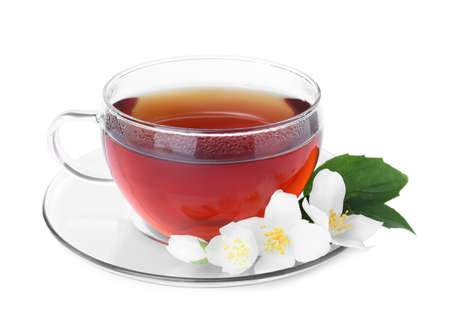 Cup of tea and fresh jasmine flowers isolated on white