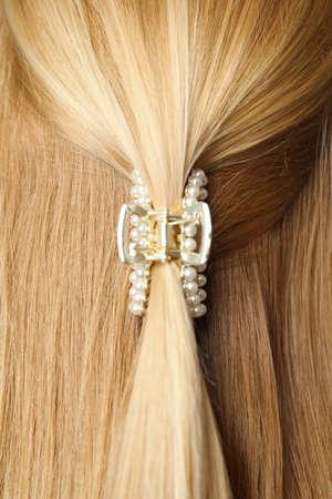 Woman with beautiful hair claw, closeup view Standard-Bild