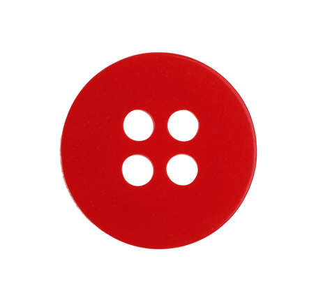 Red plastic sewing button isolated on white