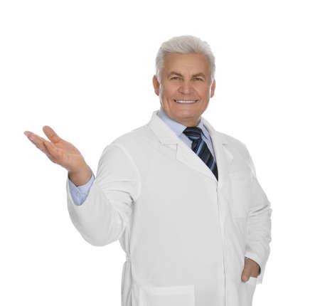 Happy senior man in lab coat on white background