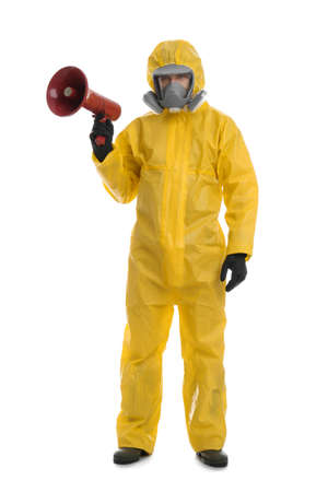 Man wearing chemical protective suit with megaphone on white background. Prevention of virus spread Standard-Bild