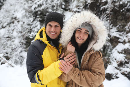 Lovely couple outdoors on snowy day. Winter vacation 版權商用圖片