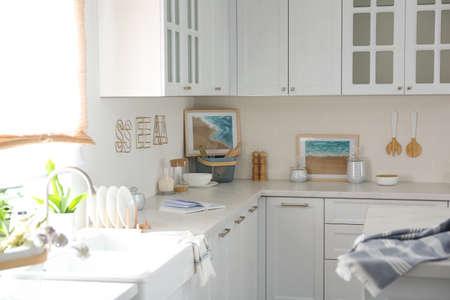 Beautiful kitchen interior with new stylish furniture Imagens