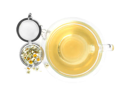 Fresh chamomile tea and dry flowers in infuser isolated on white, top view