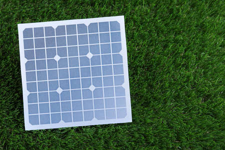 Solar panel on green grass. Space for text Banque d'images