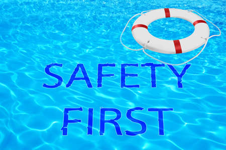 Safety first. Life buoy in swimming pool with clean blue water