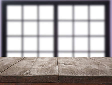 Empty wooden surface and blurred view of modern window