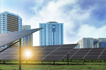 Cityscape and solar panels installed outdoors. Alternative energy source Stock Photo