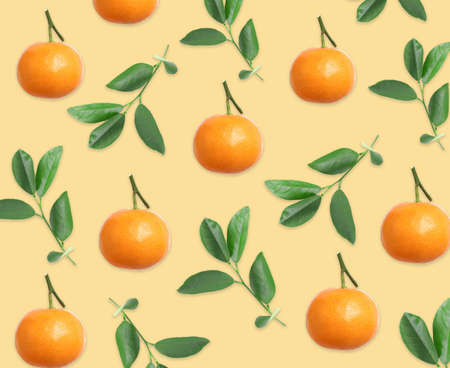 Pattern of tangerines and leaves on pale orange background