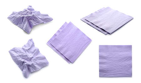 Set with violet paper napkins on white background