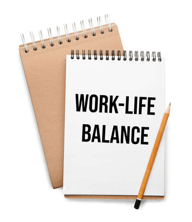 Work-life balance concept. Stylish notebooks and pencil on white background, top view Reklamní fotografie