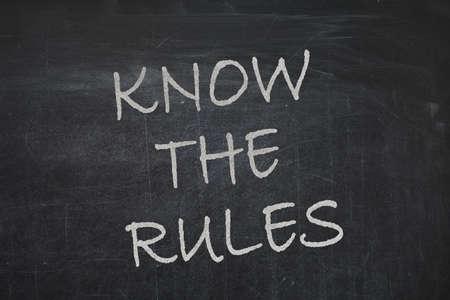 Phrase Know the rules written on chalkboard