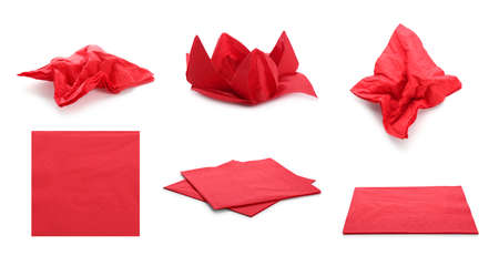 Set with red paper napkins on white background