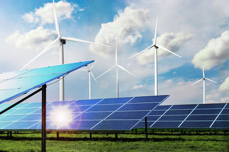 Solar panels and wind turbines installed outdoors. Alternative energy source Stock Photo