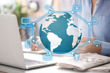 Global network technology. Woman working with laptop at table, closeup