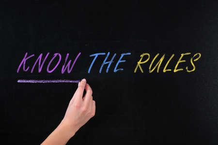 Woman underlining phrase Know the rules on black chalkboard, closeup Stock fotó