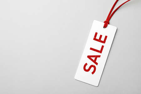 Top view of tag with inscription SALE on light background, space for text. Black Friday