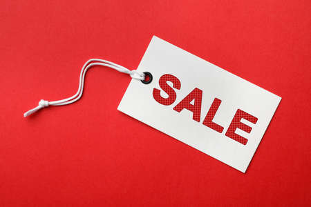 Tag with text SALE on red background, top view. Black Friday 版權商用圖片