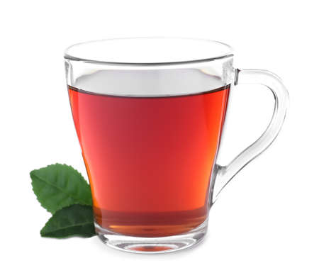 Fresh black tea and green leaves isolated on white