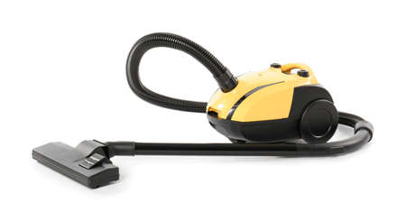 Modern yellow vacuum cleaner isolated on white Banco de Imagens