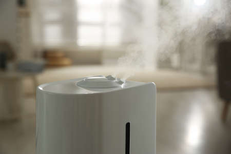 Modern humidifier on blurred background, closeup view