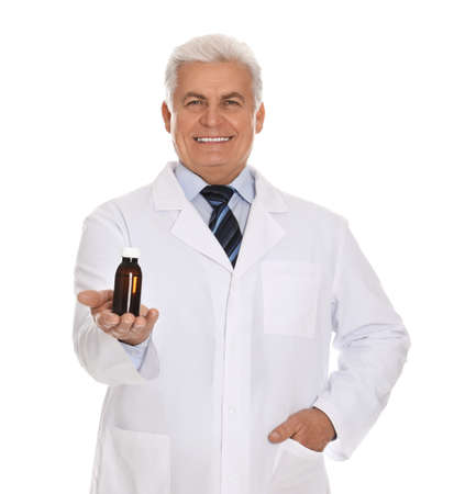 Senior pharmacist with syrup on white background