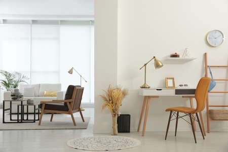 Living room and workplace in spacious apartment. Interior design