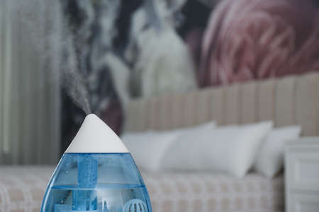 Modern air humidifier indoors, closeup. Space for text