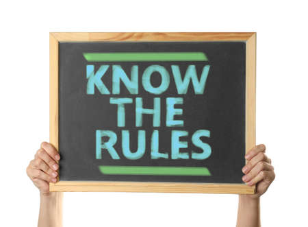 Woman holding chalkboard with phrase Know the rules on white background, closeup Stock fotó