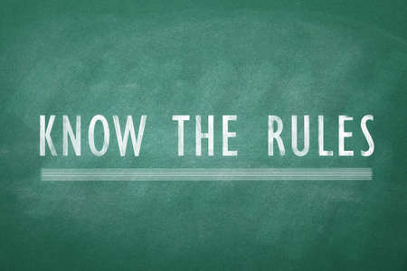 Phrase Know the rules on green chalkboard