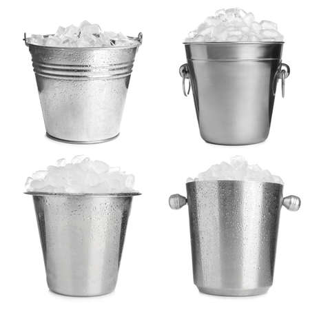 Set of different metal buckets with ice cubes on white background Stock Photo