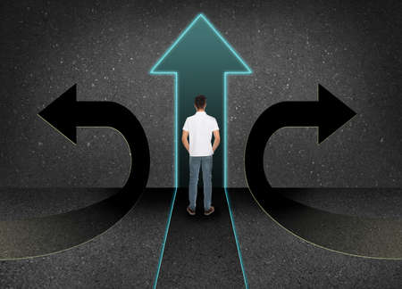 Man standing at crossroads. Concept of choice between different ways