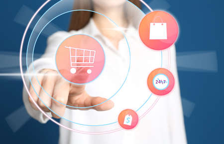 Online shopping. Woman touching button with cart illustration on virtual screen, closeup