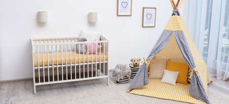 Baby room interior with comfortable crib and play tent. Banner design