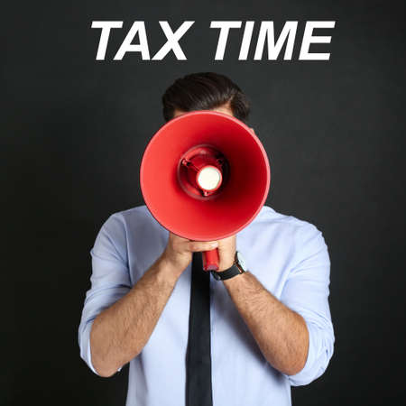 Man with red megaphone and text TAX TIME on black background