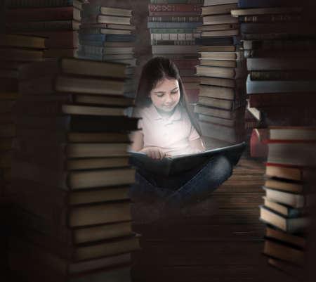 Cute little girl reading on wooden floor in room full of stacked books