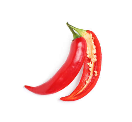 Cut red hot chili pepper on white background, top view Imagens