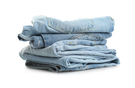 Stack of folded jeans isolated on white Stockfoto