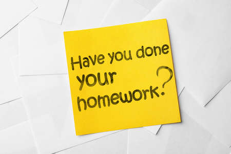 Note with phrase HAVE YOU DONE YOUR HOMEWORK? on paper sheets, top view Zdjęcie Seryjne