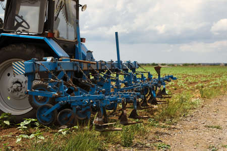 Tractor in field, closeup view. Agricultural industry